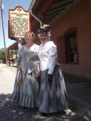 Cameo Ladies Miss April, left, and Miss Sunny, right, re-create 1880s charm in Lincoln at the Tunstall Store Museum.