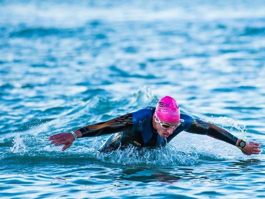 A half triathlon participant makes his way towards