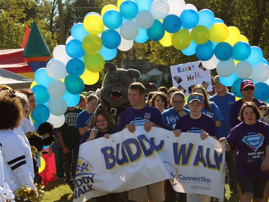 About 800 people took part in this year's Buddy Walk on Sunday at Anderson University's athletic campus. The event seeks to raise awareness and financial support for Down syndrome.