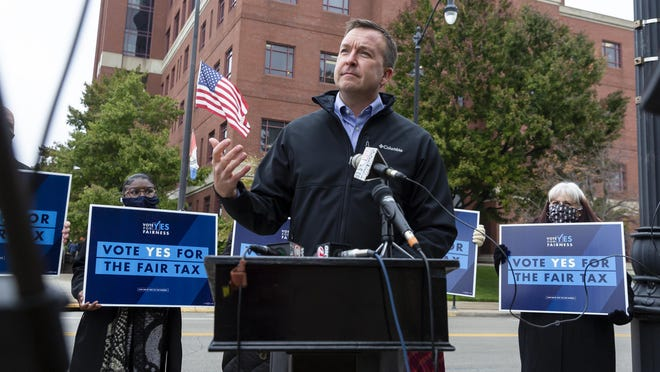 Illinois State Sen. Andy Manar, D-Bunker Hill, delivers his remarks as he is joined by leaders representing education, social services and labor urging everyone to vote early and to vote for the graduated income tax during a press conference outside the Sangamon County Complex, Tuesday, October 27, 2020, in Springfield, Ill.