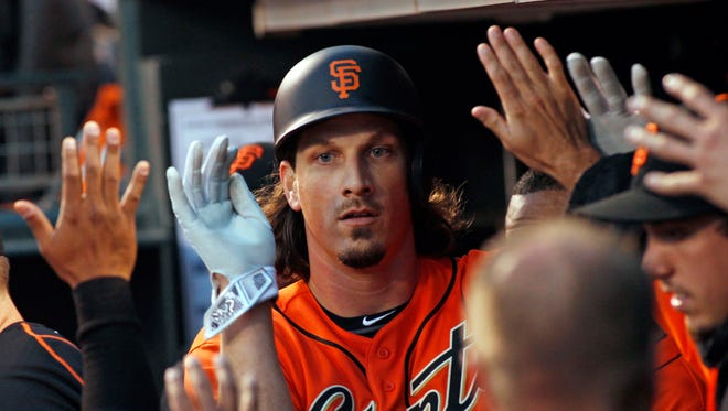 San Francisco Giants' Jeff Samardzija is greeted in the dugout after scoring against the Arizona Diamondbacks during the third inning of a baseball game, Friday, July 8, 2016, in San Francisco.