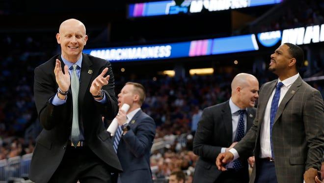 Xavier Musketeers head coach Chris Mack claps as a foul goes the way of the Musketeers in the second half of the NCAA Tournament Second Round game between the Florida State Seminoles and the Xavier Musketeers at the Amway Center in Orlando, Fla., on Saturday, March 18, 2017. The 11-seeded Musketeers controlled both halves of the game, defeating the Seminoles, 91-66, advancing to the Sweet 16.