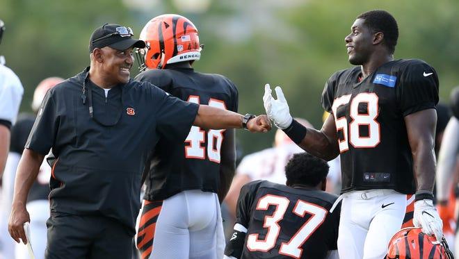 Cincinnati Bengals head coach Marvin Lewis fist bumps Cincinnati Bengals defensive end Carl Lawson (58) during Cincinnati Bengals training camp practice, Friday, Aug. 3, 2018, on the practice fields next to Paul Brown Stadium in Cincinnati.