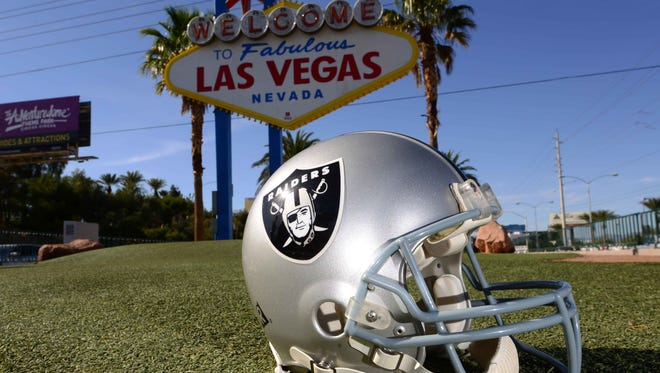 """General view of Oakland Raiders helmet at the """"Welcome to Fabulous Las Vegas"""" sign on the Las Vegas strip."""