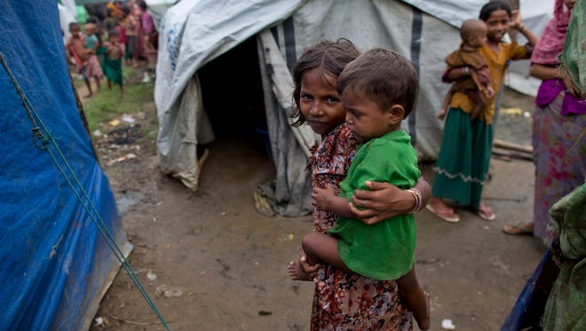 Muslims who were displaced in the 2012 sectarian violence live in Nga Chaung Refugee Camp in Pauktaw, Rakhine state, Myanmar, Sept. 17, 2013.