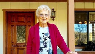 Betty Strain, 90, on the porch of her hilltop home in the foothills of the Sierra Nevada Mountains.