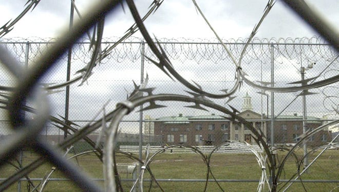 The Chillicothe Correctional Institution is seen through chainlink fence and razorwire in this 2002 USA Today Network file photo.
