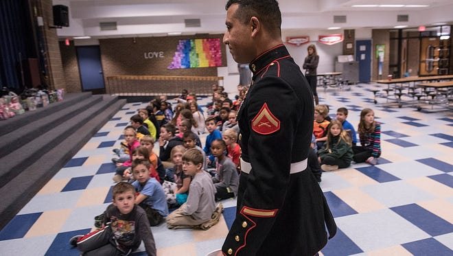 Marine Corps Reserves Lance Corporal Roman Yousof comes to Hoben Elementary to thank third-grade students for their contributions to the Toys for Tots program.
