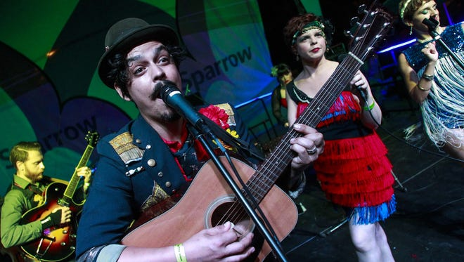 Dylan Andrew MacNaughton Rogers, frontman of the Lansing Unionized Vaudeville Spectacle performs Sunday, July 12, 2015, during the final evening of the Common Ground Music Festival at Adado Riverfront Park in downtown Lansing.