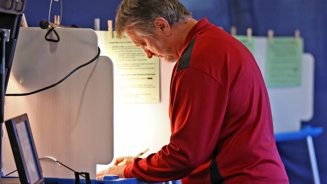Bill Hodgson votes at Hinkle Fieldhouse for the primary election, Tuesday, May 8, 2018.
