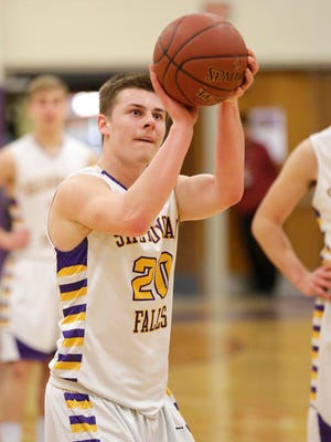 Sheboygan Falls' Trey Hake (20) aims a free throw against St. Lawrence Seminary high Tuesday March 1, 2016 at Falls.
