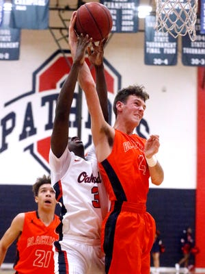 Blackman's Nathan Nelson (4) and Oakland's DeArre McDonald (3) defends him on Friday, Feb. 9, 2018, at Oakland.
