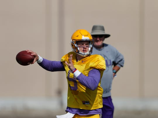 LSU quarterback Joe Burrow (9) works out during their NCAA college football practice in Baton Rouge, La., Wednesday, Aug. 7, 2019. (AP Photo/Gerald Herbert)
