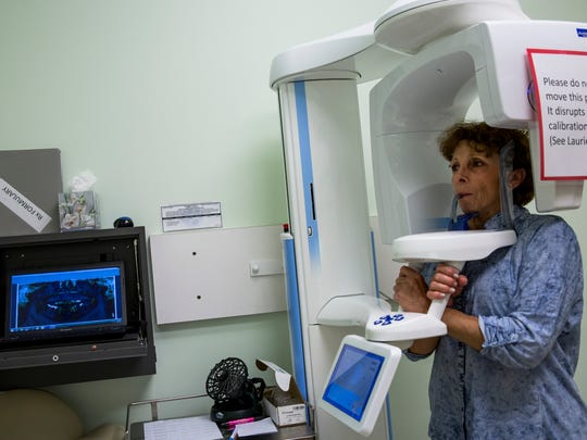 Ana Praxedes, 62, has her teeth X-rayed at the Neighborhood Health Clinic in Naples, Fla., on Monday, Dec. 5, 2016. The clinic, which serves uninsured working adults in Collier, is planning a dental expansion to address a backlog of patients.