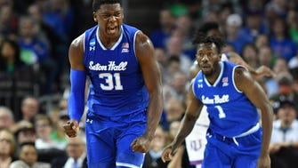 Seton Hall Pirates center Angel Delgado (31) celebrates after a basket against the Kansas Jayhawks in the first half in the second round of the 2018 NCAA Tournament at INTRUST Bank Arena.