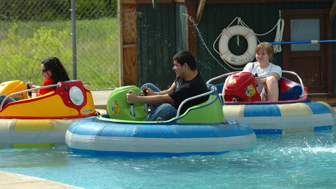A group enjoys spraying each other while riding the bumper boats at The Plex in this file photo from April 2007. Wichita Falls businessman Harry Patterson and a few other investors have purchased the 22-year-old complex and will operate it under the name The Family Fun Zone.