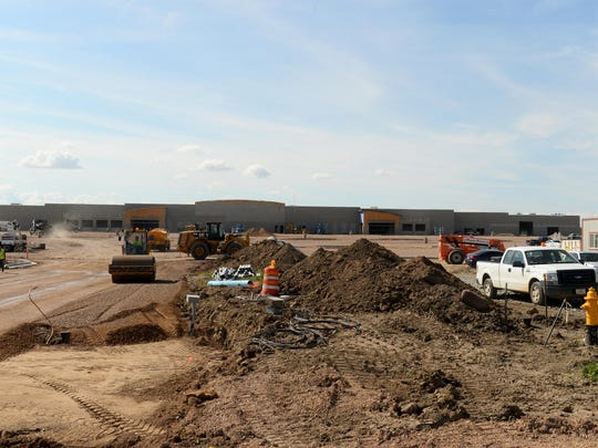 About 100 workers with prime contractor R & O Construction and subcontractors are working on the Wal-Mart on the east end of 10th Avenue South.