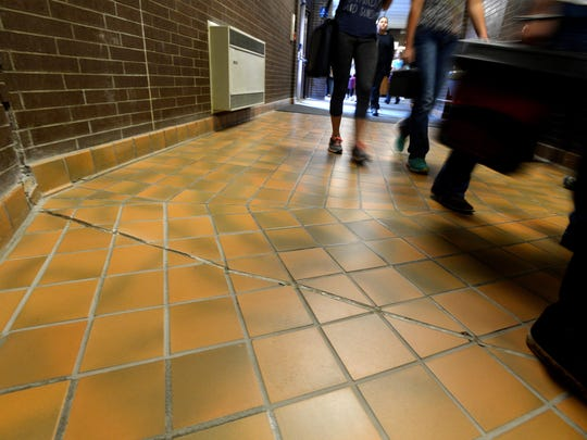 North Middle School students hurry to their next class Sept., 6. Uneven floors and shifting walls are some of the problems at North Middle School that will be addressed through a school bond.