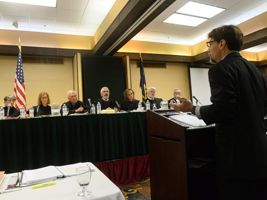John Smeltzer, an attorney with the U.S. Department of Justice, delivers oral arguments for the BLM to the justices of the Montana Supreme Court on Friday during oral arguments in the case of BLM v. South Phillips County Water Users Group at the Holiday Inn in Great Falls. The Montana Supreme Court held these oral arguments at the State Bar of Montana's annual meeting.