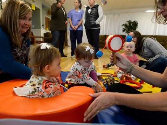 Sarah Goldsmith and her twin daughters, Isabella and Olivia, participate in the the Tippy Toes program by Eagle Mount's Jill Van Son on Thursday morning. The inclusive program for both able-bodied and disabled toddlers and their parents exposes them to movement, music and play.