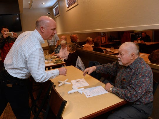 Greg Gianforte meets Gary Schlaeger at the Pachyderm Club's weekly meeting on Thursday at Rikki's Pizza.