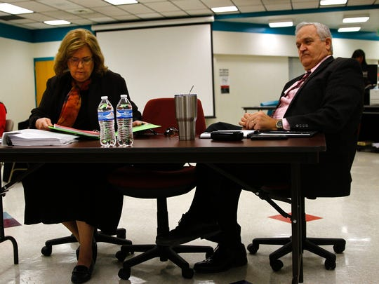 Attorney Eleanor K. Bratton and embattled Central Consolidated School District Superintendent Don Levinski prepare for Levinski's discharge hearing Thursday in the Central Consolidated School District boardroom in Shiprock.