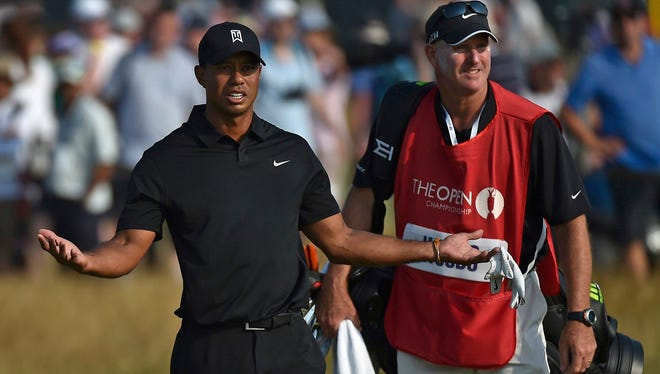 Tiger Woods of the U.S. reacts on the 17th fairway after being told his tee shot was out of bounds during the second round of the British Open Championship at the Royal Liverpool Golf Club in Hoylake, northern England July 18, 2014.