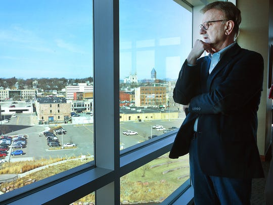 SculptureWalk director Jim Clark looks over where the