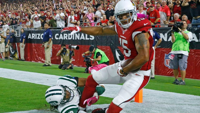 Arizona Cardinals wide receiver Michael Floyd (15) catches a touchdown behind New York Jets cornerback Darryl Roberts (27) in the 2nd half of their NFL game Monday, Oct. 17, 2016 in Glendale, Ariz.
