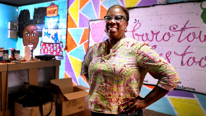 Lisa Rouse shows off her new restaurant location for Boro Town Cakes Too, with local artwork on the walls, on Monday, July 23, 2018. The location will work in conjunction with the current Boro Town Cakes.