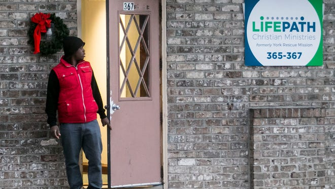 Volunteer Brandon McIntosh, of Gettysburg, walks out of LifePath Christian Ministries Thursday, Dec. 1, 2016, in York City. Late Wednesday night, the community lost longtime client Raymond Updegraff, who was killed while being struck by an unmarked police cruiser in East Manchester Township. Amanda J. Cain photo