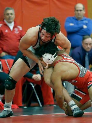 182-pound division: Penfield's Frankie Gissendanner defeated Hilton's Sammy Deprez at Hilton High School.