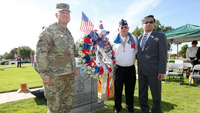 Col. Robert E. Lee Magee, commander of the 3rd Armored Brigade Combat Team, 1st Armored Division; Roy Aldridge, president of the Korean War Veterans Association; and Myoung-Joon Kim, deputy Consul General of the Republic of Korea, stand at the Korean War Memorial on Thursday.