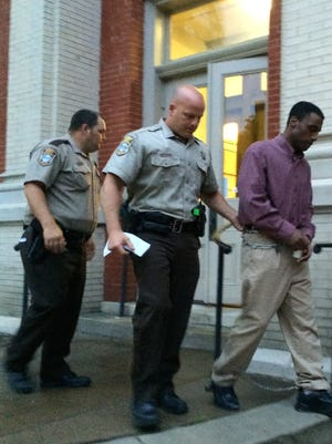 Kenneth H. Vaughn is led away from the Augusta County Courthouse on Wednesday after being found not guilty on charges of rape and forcible sodomy.