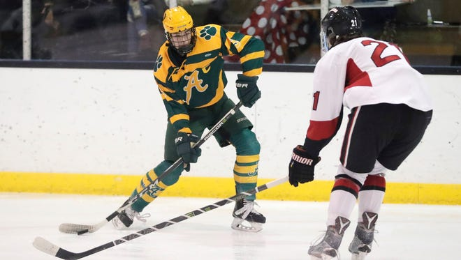 Ashwaubenon's Tyler Roethlisberger (9) shoots against De Pere in a Fox River Classic Conference hockey game Friday at the De Pere Ice Arena.
