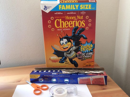 A DIY eclipse finder can be made out of a cereal box and tin foil.