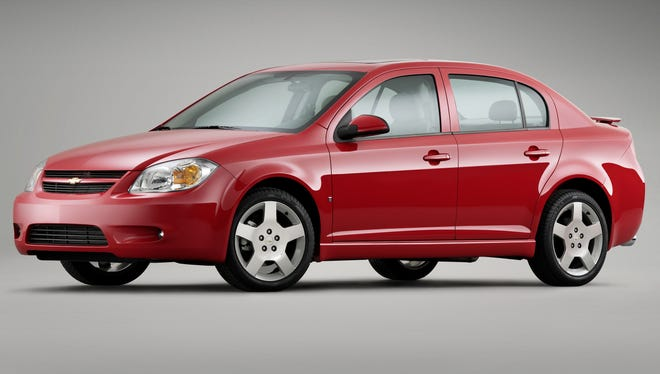 A $1.3 billion charge for the costs if the ignition switch recall of cars including this 2008 Chevy Cobalt is likely to bring GM quarterly loss.