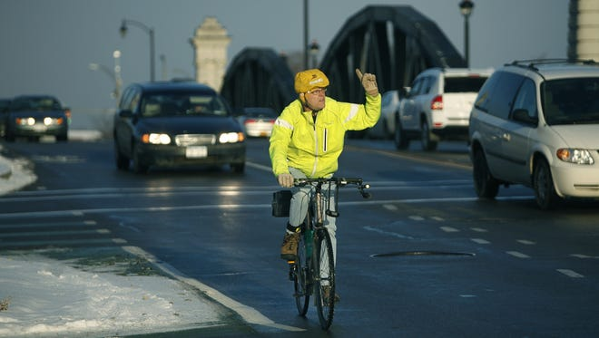 Cyclist Scott Wagner takes the Ford Street Bridge to make his way from Mt. Hope Avenue to East Henrietta Road after leaving his Corn Hill home in Rochester, N.Y.
