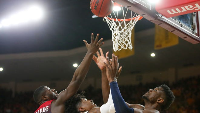 Arizona Wildcats guard Rawle Alkins (1) and forward Deandre Ayton (13) battle Arizona State Sun Devils forward Romello White (23) for the rebound during a men's basketball game at Wells Fargo Arena in Tempe on February 15, 2018.