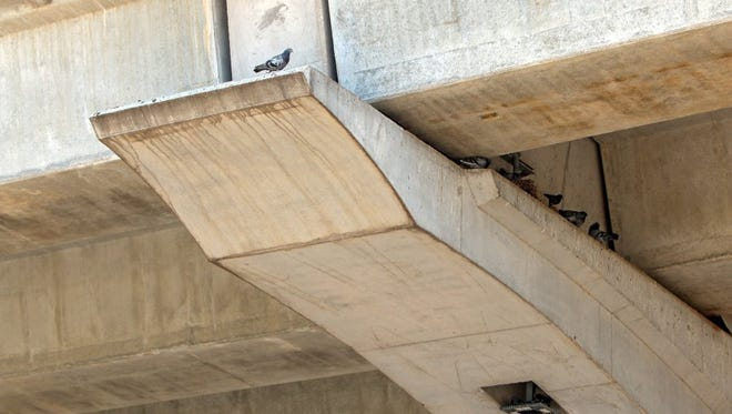 Pigeons pile under an overpass near Broad and Holliday streets in Wichita Falls. The city regularly traps and removes the birds, but some people are vexed about the birds' treatment while in the cages.