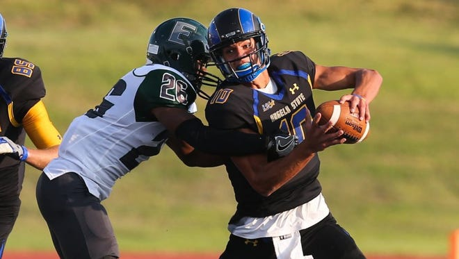 Angelo State quarterback Jake Faber tries to evade an Eastern New Mexico defender last year.