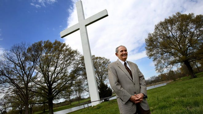 Buddy Runnels stands in front of a 50-foot-tall cross on the Circle G Ranch, which he bought in 2014.