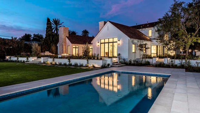 Charles Carey, a physician's assistant specialist, and his wife, Lisa, a professor in breast cancer research,paid cash for this 5,400-square-foot estate in Phoenix's Arcadia Replat community.