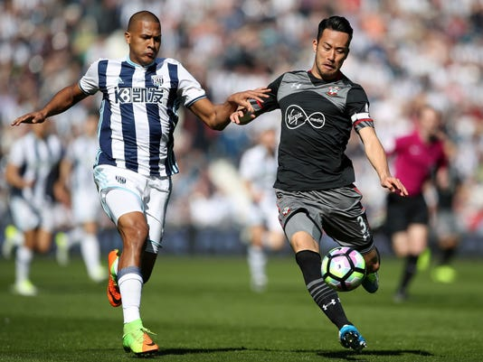 West Bromwich Albion's Jose Salomon Rondon, left, chases after Southampton's Maya Yoshida during their English Premier League soccer match at The Hawthorns in West Bromwich, England, Saturday April 8, 2017. (Nick Potts/PA via AP)