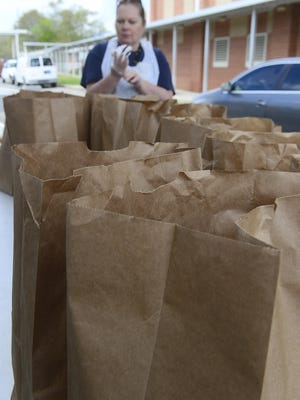 Lunchroom workers and administration of West End High passed out hundreds of bags of food, juices and milks to relatives of school children in the West End district on Monday, March, 30, 2020.