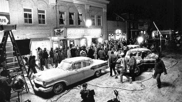 """Filmmakers shoot a """"Dead Poets Society"""" scene outside Middletown's Everett Theatre in December 1988. The """"snow"""" on the ground was created with crushed marble and limestone. Sidewalks and trees were sprayed with soap."""