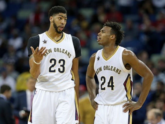 The New Orleans Pelicans' Anthony Davis, left, and Buddy Hield talk during a break at the Smoothie King Center. New Orleans found itself a team when the Charlotte Hornets ownership group encountered financial difficulties and arena issues in 2002.