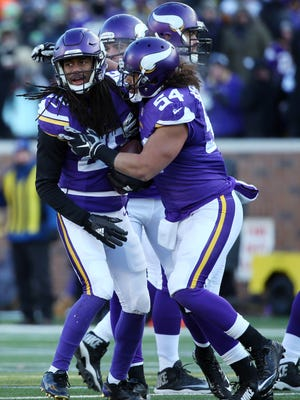 Minnesota cornerback Trae Waynes (26) celebrates with teammates after his first career interception against Seattle during the third quarter of their NFC Wild Card playoff game in January.