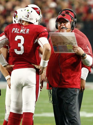Arizona Cardinals Carson Palmer and coach Bruce Arians talk during a timeout against the Green Bay Packers during an NFC playoff game on Jan. 16, 2016, in Glendale, Ariz.
