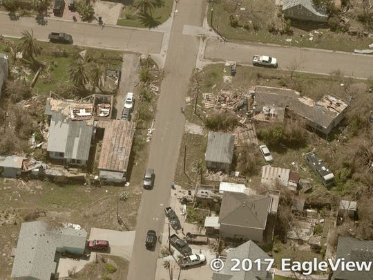 Aerial photo of Houston neighborhood shows damage to houses after Hurricane Harvey
